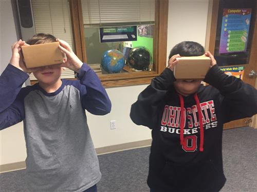 Photo of students looking through Google Cardboard