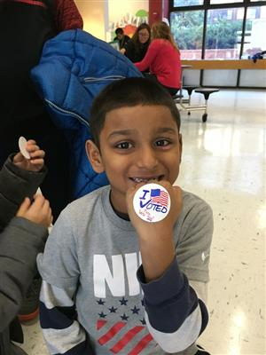 Student with I voted button